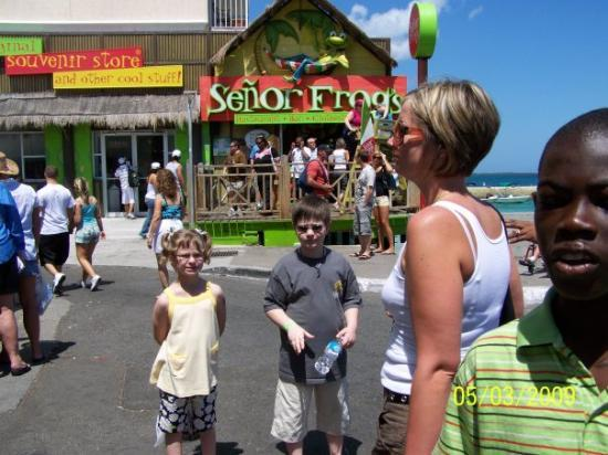 Señor Frog's: Kids outside straw market Nassau with Senor Frogs behind them. Sorry not Kate from Jon and Kate