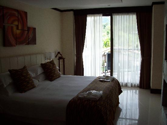 The Royal Corin Thermal Water Spa & Resort: Bedroom area with balcony access.