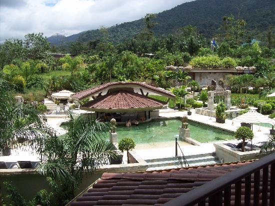 The Royal Corin Thermal Water Spa & Resort: View from the balcony (pools, grounds and Arenal).