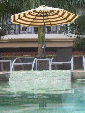 The Royal Corin Thermal Water Spa & Resort: Tiled loungers in the water, deluxe loungers poolside.