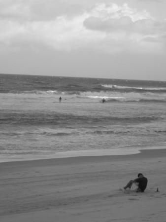 Surfers Paradise Beach: some dude doing sit ups while the sand was blowing everywhere