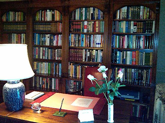 Spencer On Main: Desk and some bookcases in sitting room