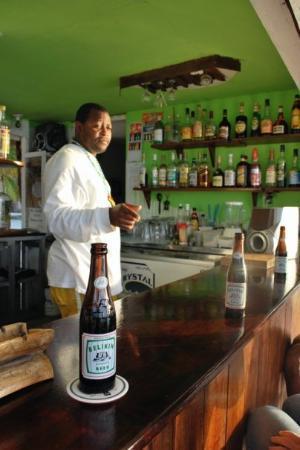 Tobacco Caye, Belize: Blinky serving up more Belikin's