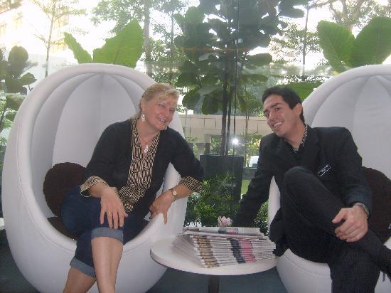 The Quincy Hotel by Far East Hospitality: Reuben and I chat in the trendy lobby chairs, free newspapers available daily.