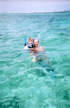 Ambergris Divers: Danielle and our son in Belize. LOVE that water!