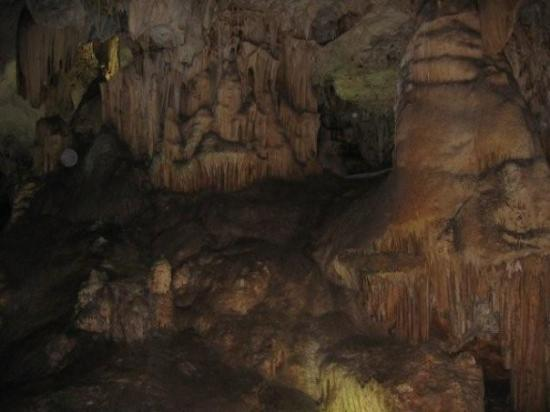 Cueva de Nerja: The cave is huge and moderately poorly lit to prevent growth of verdigris