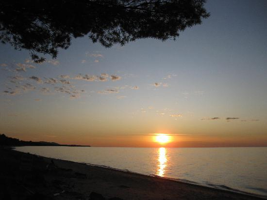 Ontonagon, MI: Sunset from Superior Shores Resort beach. Porcupine Mts seen in distance on left.