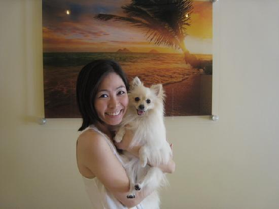 Snowy & Kimi in front of one of Aqua Waikiki Pearl's beautiful photos