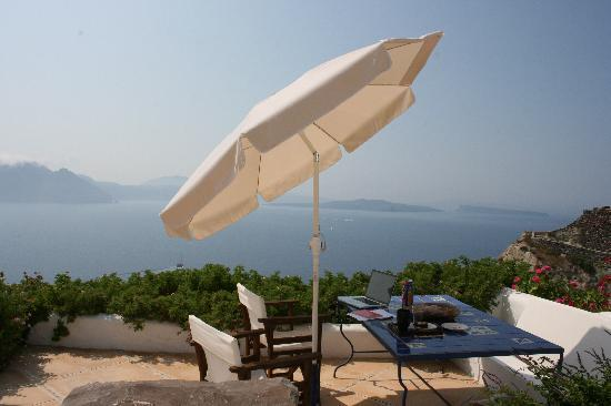my laptop on the table, on the deck, with the gorgeous view at Ifestio Villas!!!