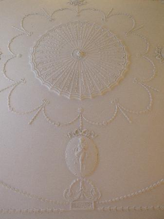 The Town House: Section of ornate ceiling in room