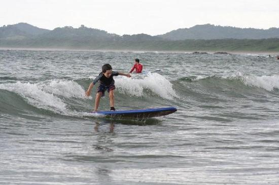 Hotel Casa Sueca: My son's first wave ever - in Tamarindo Beach