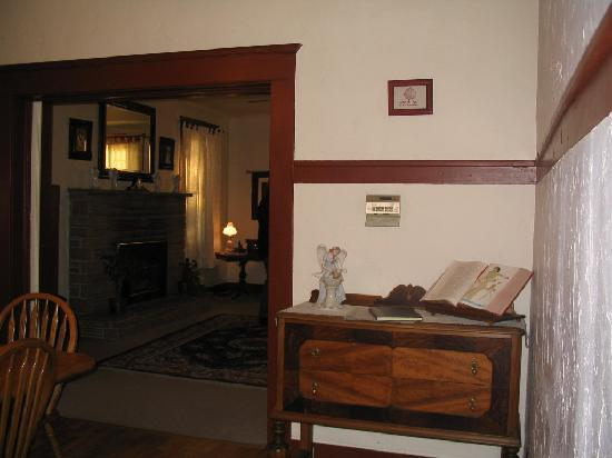 Aspen Inn Bed and Breakfast: View of fireplace from diningroom