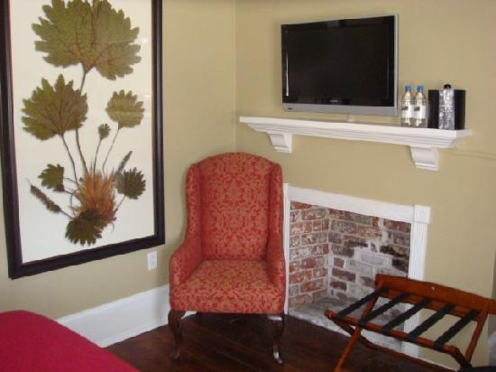 The Marshall House: The fireplace & TV in the room.