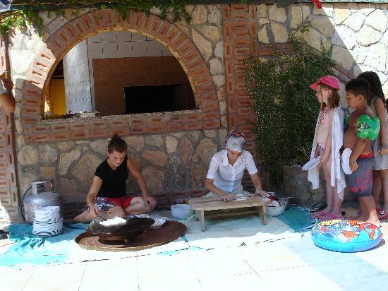 Club Big Blue Suite Hotel: the turkish ladies making sweetbread. The kids loved this !
