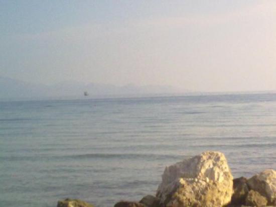 Alykes, Grækenland: ALYKANA Looking out to KEFALONIA. Cargo boat in shot