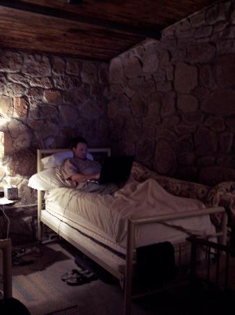 The Stone Village Tourist Camp: David utilizing the wireless internet while enjoying the comfortable beds.