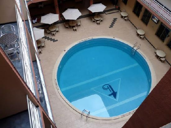 Triangle Hotel: view from upper floor down to basic restaurant and small swimming pool