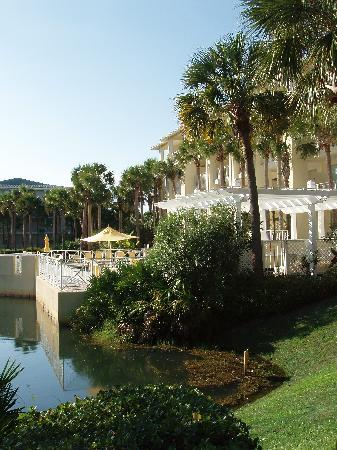 Gulf Place: view of condo from side, pool and pond