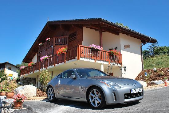 Chalet des Alpes: Our car in the foreground- Chalet in the back