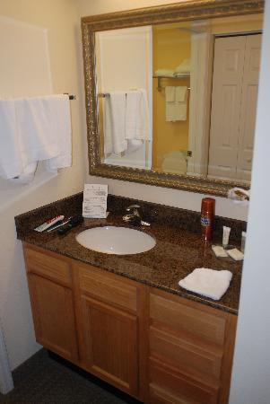 Staybridge Suites near Hamilton Place: The sink area of the bathroom with the rooms only Mirror.