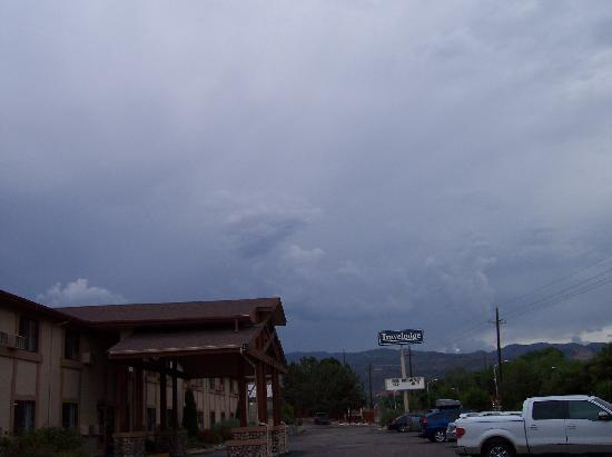 Travelodge Colorado Springs: View of the front of the hotel with a thunderstorm over Pikes Peak