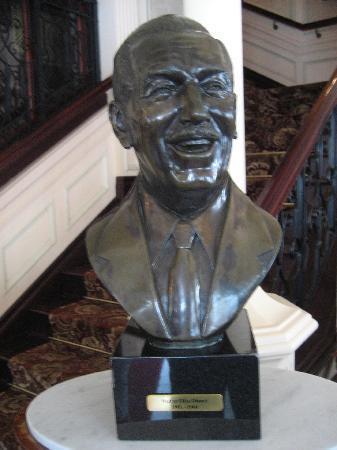 Walt's - an American Restaurant : Statue of Walt in restaurant reception.