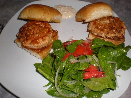 CRaVE: Salmon Cake Sliders with a tomato onion salad.