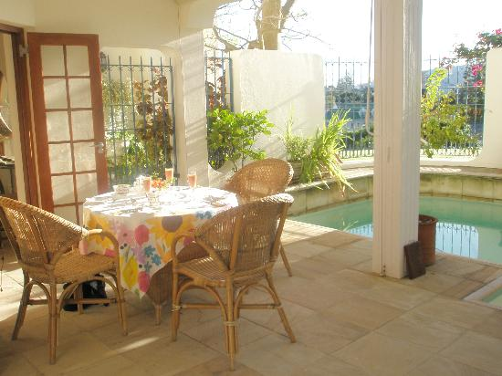 Halcyon House: Breakfast Table near the pool