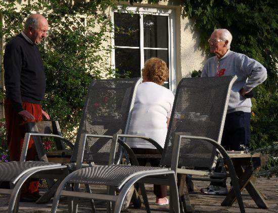 Hartwood House: David and guests after breakfast in the garden.