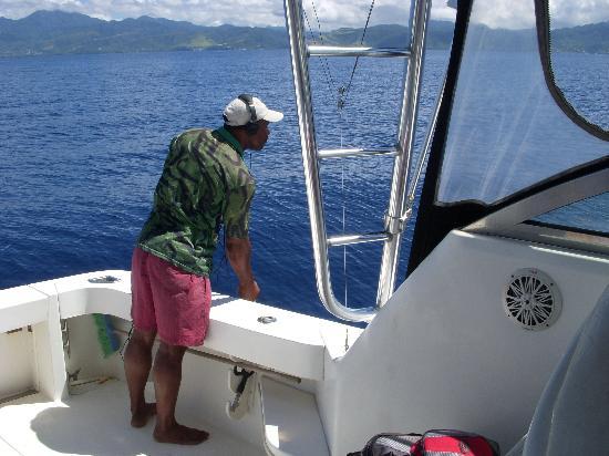 Dominique : Captain Jerry listening for whales