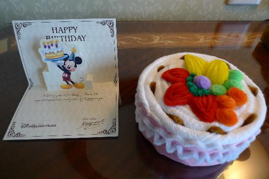 Birthday card from Mickey Mouse and a birthday towel cake Picture
