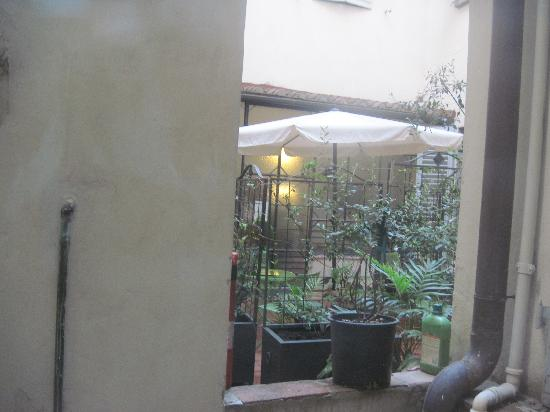 Hotel Axial: View of the courtyard from the bedroom