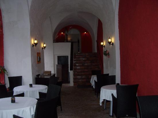 Villa Regina: open patio at entrance to main dining rooms
