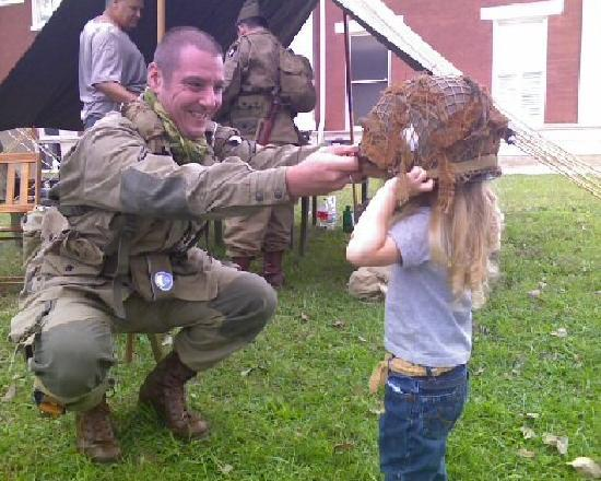 Toccoa, GA: A re-enactor makes a small friend during Currahee Military Weekend, an annual event in October.