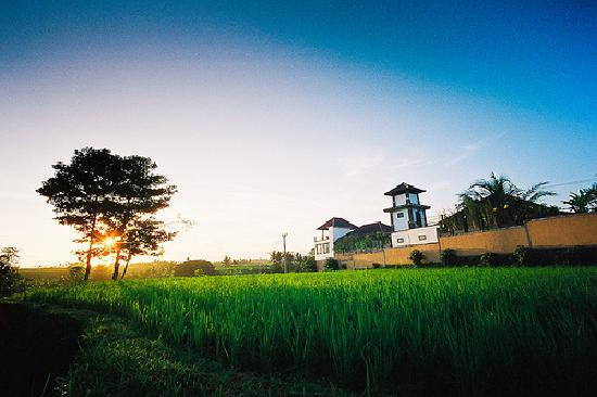 Balam Bali Villa: Exterior of the villa with sunset in background
