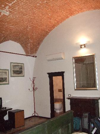 Accademia House: The room has nice high ceilings, with interesting brick work.