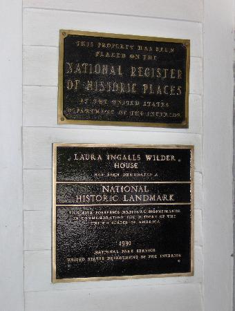 Laura Ingalls Wilder Historic Home and Museum: National Historic Landmark plaque - posted inside back porch