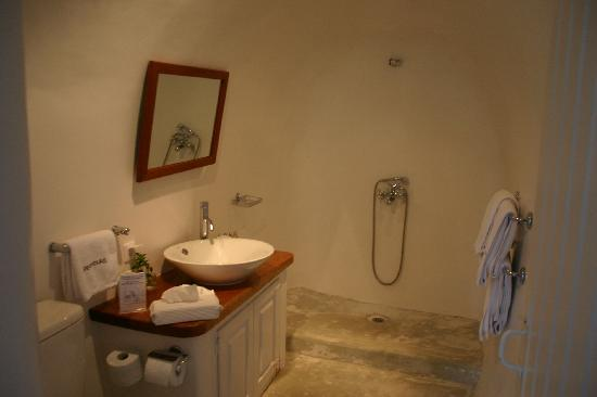Perivolas: The bathroom in our suite.  The open shower was a new experience for us.