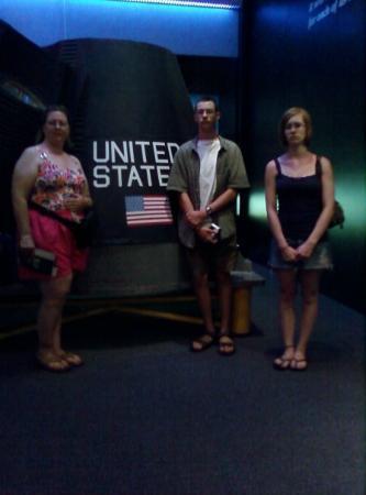 U.S. Astronaut Hall of Fame: Titusville, FL, United States Renee, Travis, and Samantha beside a Mercury model.
