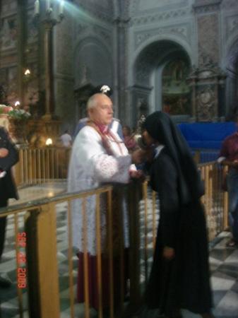 Via San Gregorio Armeno: Nun kissing the vile of saint's blood (the miracle of San Gennaro)