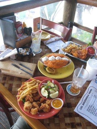 Squid Lips Overwater Grill: Coconut shrimp. Giant sweet potato. Buffalo chicken