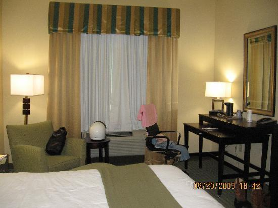 Holiday Inn Express Hotel & Suites Gulf Shores: huge desk area /  plush chair with ottoman