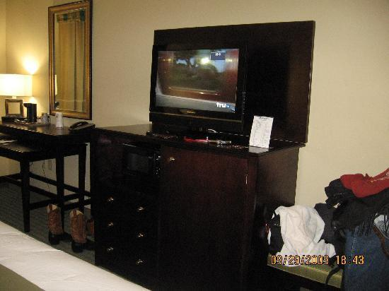 Holiday Inn Express Hotel & Suites Gulf Shores: large tv / large refrigerator