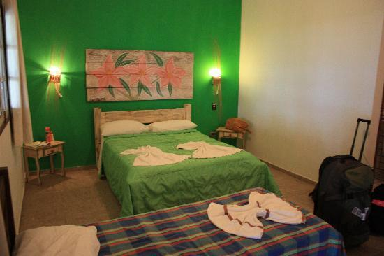 Xales de Maracaipe Pousada: Our room with two beds.