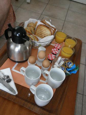 Neoklassiko Koukouli : Breakfast, as delivered to our room.  Grilled ham & cheese, various breads, eggs, coffee or tea,