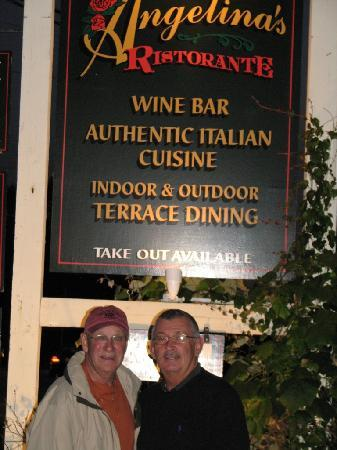 Angelina's Ristorante & Wine : Here are a couple of us going under the sign.