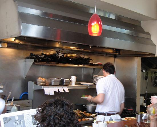 Nob Hill Grille Restaurant : Open kitchen in full view of upstairs. So fun to watch them cook!