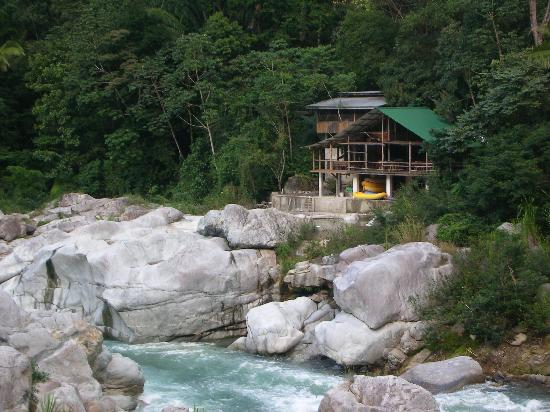 view of Jungle River Lodge from across the river