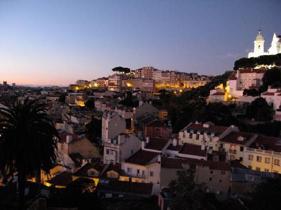 Olissippo Castelo: View from room 403. Right the illuminated Miradouro da Graça.