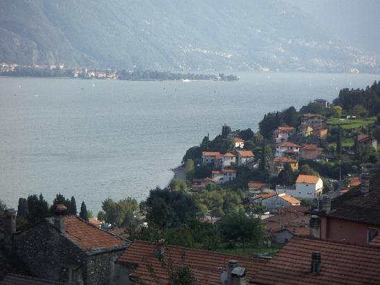 Pianello del Lario, Ιταλία: The restaurant is right on the beach, at the bottom of this hill, lovely location and view